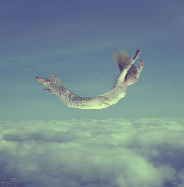 Adolescence Photograph - Girl Flying Over Sky With Eyes Close by Emily Moya