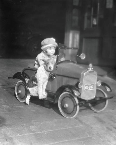 Pedal Car Wall Art - Photograph - Girl In Toy Pedal Car With Dog Sitting by H. Armstrong Roberts