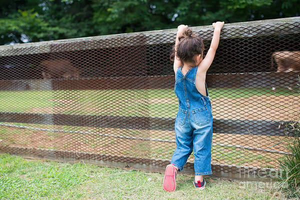 Wall Art - Photograph - Girl Playing Wearing Overalls by Purino