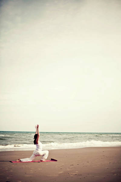 Practice Photograph - Girl Practicing Yoga On The Beach by Lindaobrien Photography