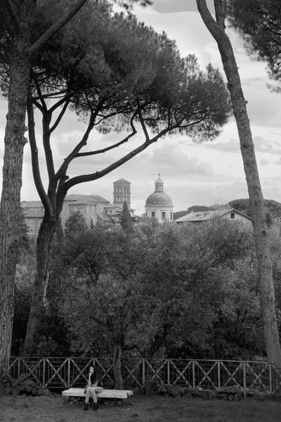Photograph - Girl Sitting On A Bench Beneath Umbrella Pines On Palatine Hill Rome Italy In Black And White by Angela Rath