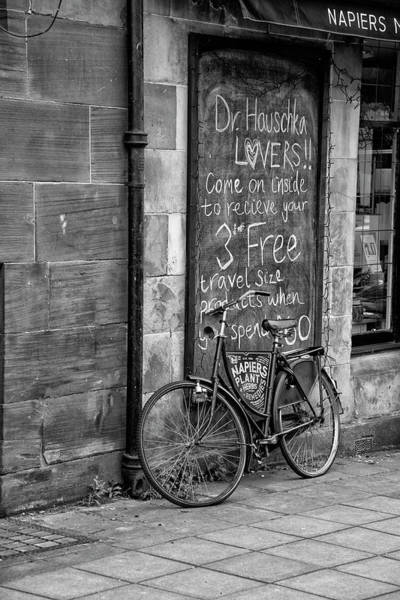 Photograph - Glasgow Bike In Front Of Shop In Black And White by Bill Cannon