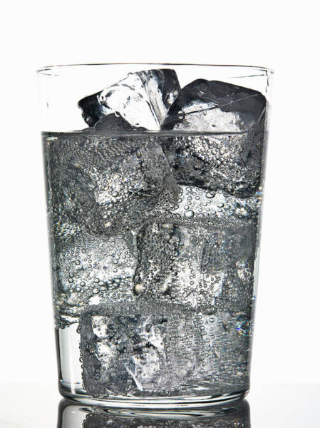 Glass Of Ice Cubes In Fizzy Drink Art Print by Walter Zerla