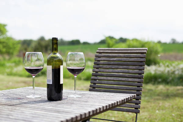 Bottle Green Photograph - Glasses And A Bottle Of Red Wine On An by Halfdark