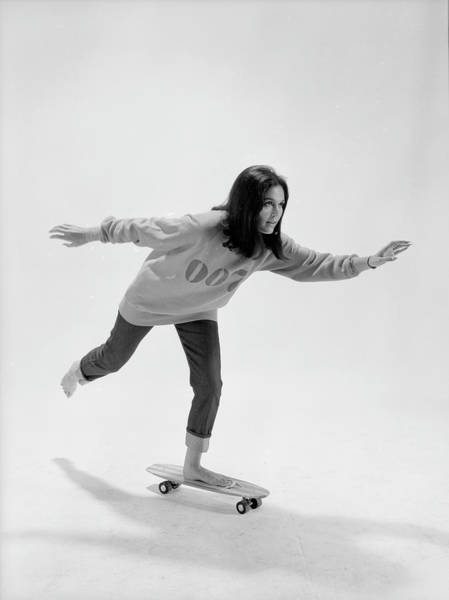 Vertical Photograph - Gloria Steinem On A Skateboard by Yale Joel