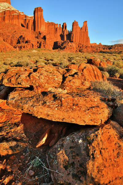 Photograph - Glowing Fisher Towers And Boulders At Sunset In Utah by Ray Mathis