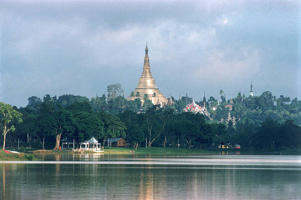 Photograph - Gold Spire And Roof Of The Shwe Dagon by John Dominis