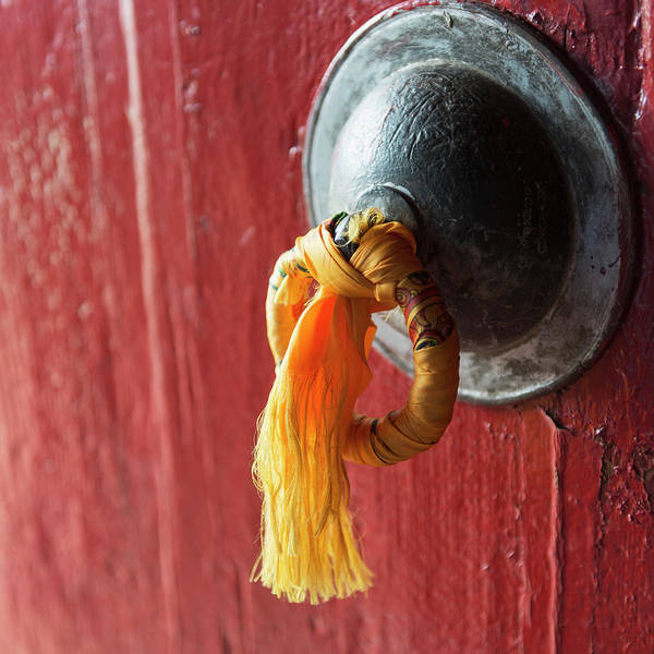 Wall Art - Photograph - Gold Tassel Tied To A Doorknob On A Red by Keith Levit / Design Pics