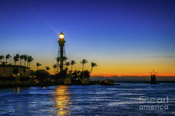 Photograph - Golden Lighthouse Reflection by Tom Claud