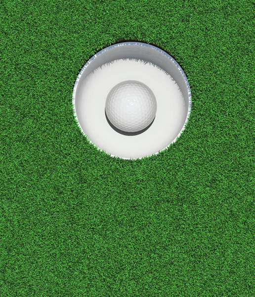 Luck Photograph - Golfball In Golf Hole by Atomic Imagery