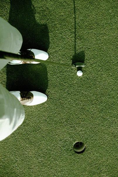 Golf Photograph - Golfer Putting On A Green by Ken Reid