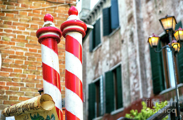 Photograph - Gondola Poles In Venezia by John Rizzuto