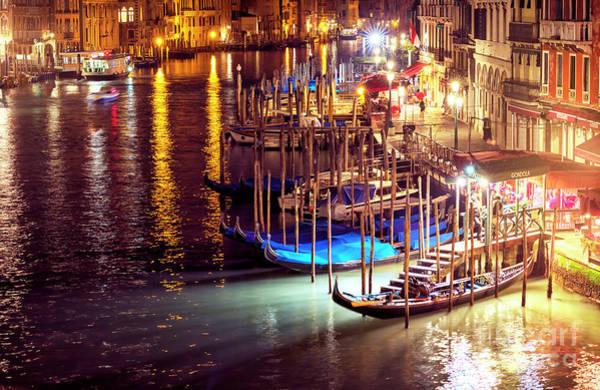 Photograph - Gondolas At Night In Venice by John Rizzuto