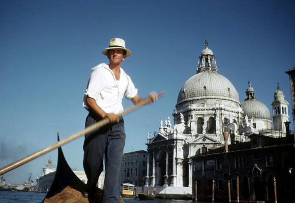 Photograph - Gondolier In Venice Italy by Michael Ochs Archives