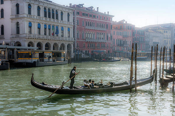 Photograph - Gondolier On The Grand Canal In Venice by Wolfgang Stocker