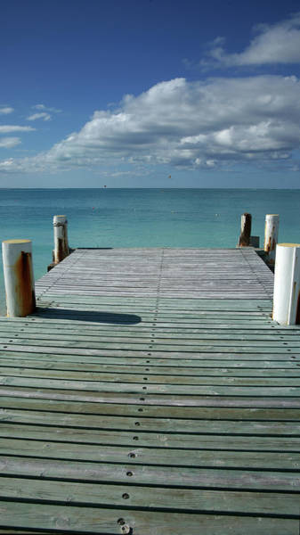 Into The Woods Wall Art - Photograph - Grace Bay Wooden Pier On The Island Of by Greg Newington