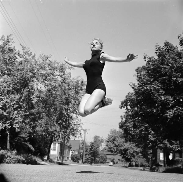 Suburbs Photograph - Graceful Leap by Orlando