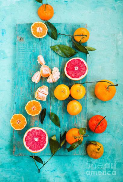 Wall Art - Photograph - Grapefruit, Mandarin, Clementine Sliced by Casanisa