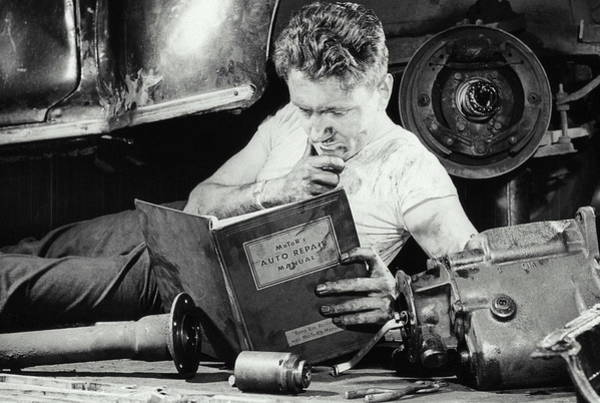 Learning Photograph - Greasy Mechanic On Garage Floor, Manual by Archive Holdings Inc.