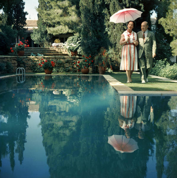 Parasol Photograph - Greek Garden by Slim Aarons