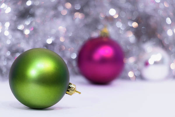 Photograph - Green And Fuchsia Christmas Balls And Lights In Background. Wint by Cristina Stefan