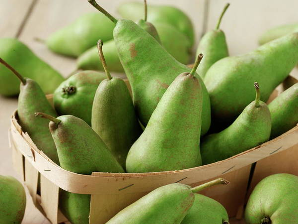 Fruit Photograph - Green Pears In Punnet And Wooden Table by Chris Ted