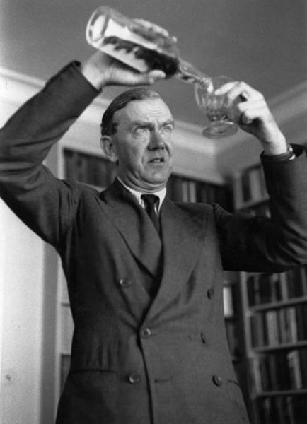 Scriptwriter Photograph - Greene Pours Drink by Kurt Hutton