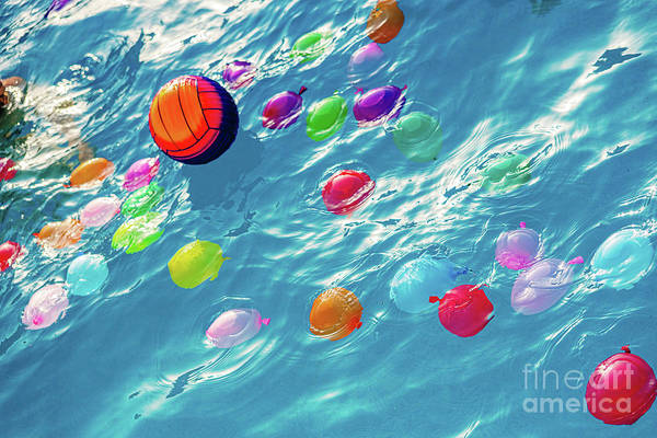 Photograph - Group Of Many Colorful Plastic Water Balloons Floating In The Wa by Joaquin Corbalan