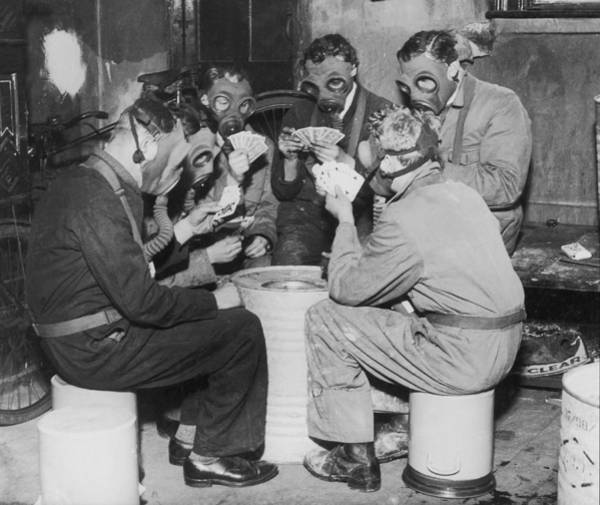 Protective Clothing Photograph - Group Of Men Playing Cards, Wearing Gas by Fpg