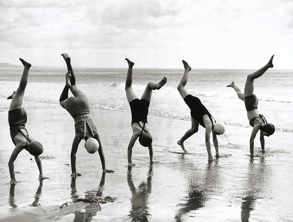 Photograph - Group Of People Doing Handstands On by Hulton Archive