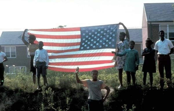 Wall Art - Photograph - Group W. Amer. Flag Standing On by Bill Eppridge