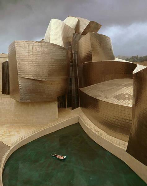 Guggenheim Wall Art - Photograph - Guggenheim Museum And Swimmer. Bilbao by Miguel Palacios