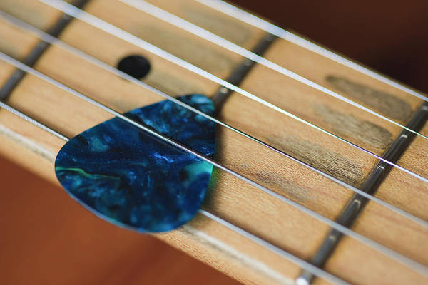 Music Hall Photograph - Guitar Strings And Plectrum by Fraser Hall