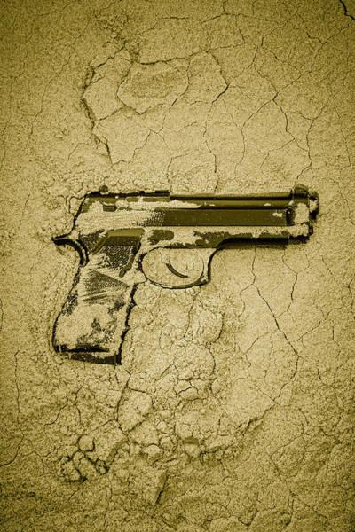 Beretta Wall Art - Photograph - Gun In Sand by Richard Nixon