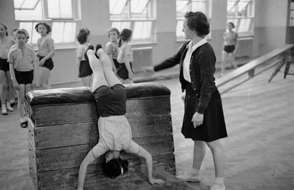 Upside Down Photograph - Gym Lesson by Bert Hardy