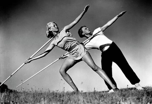 Javelin Photograph - Gym Teachers Throwing Javelins At Hidden by Alfred Eisenstaedt