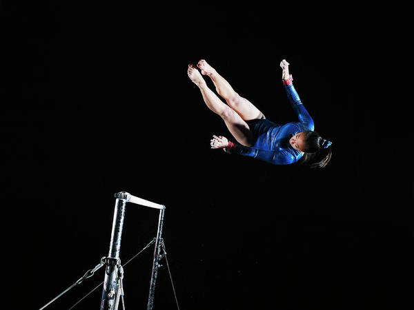 Bar Photograph - Gymnast 16-17 Dismounting Uneven Bars by Thomas Barwick