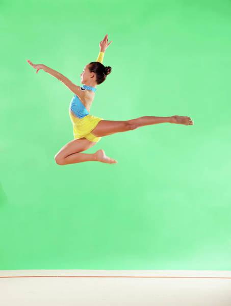 Wall Art - Photograph - Gymnast,  Mid Air, Jump, Profile by Emma Innocenti