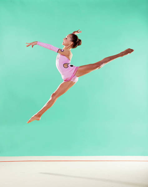 Hand Photograph - Gymnast,  Mid Air, Split, Pink Leotard by Emma Innocenti
