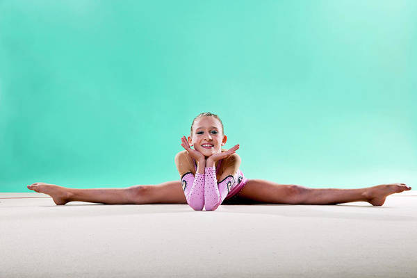 Toothy Smile Photograph - Gymnast, Smiling, Side Split, Head On by Emma Innocenti
