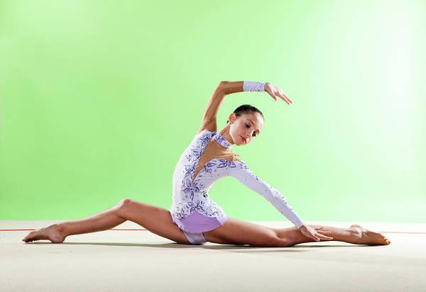 Wall Art - Photograph - Gymnast, Split Floor Looking Back by Emma Innocenti