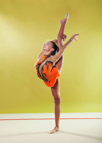 Toothy Smile Photograph - Gymnast, Standing, Holding Back Leg Up by Emma Innocenti