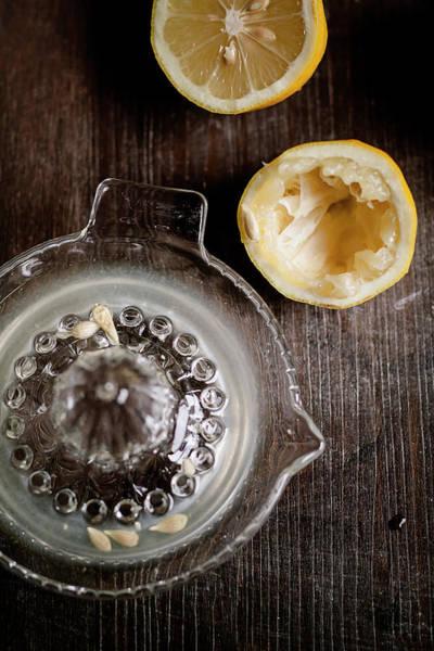 Lemon Photograph - Halfs Of Squeezed Lemon, Lemon Squeezer by Westend61