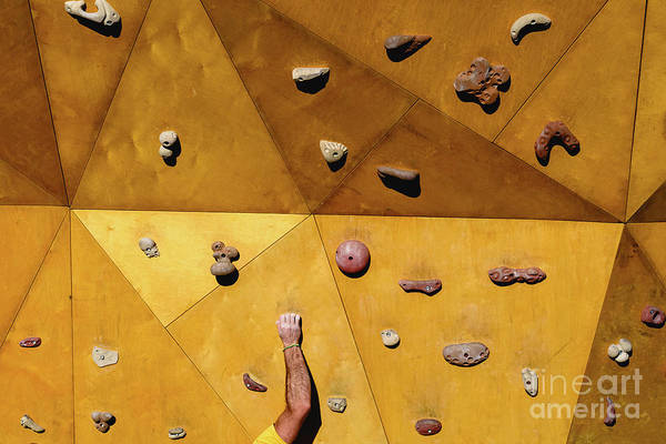 Photograph - Hand Of A Person Trying To Climb The Fixie Of A Climbing Wall by Joaquin Corbalan
