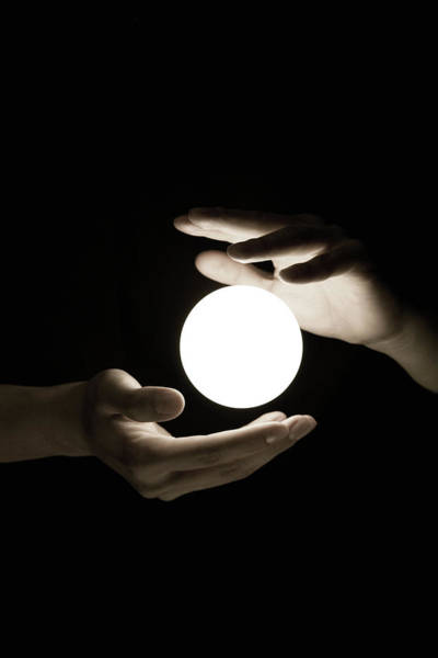 Resourceful Photograph - Hand Shielding Glowing Lightbulbs by Mojito / Multi-bits