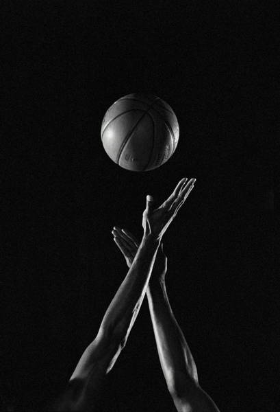 Human Hand Photograph - Hands Reaching For Basketball by Mike Powell