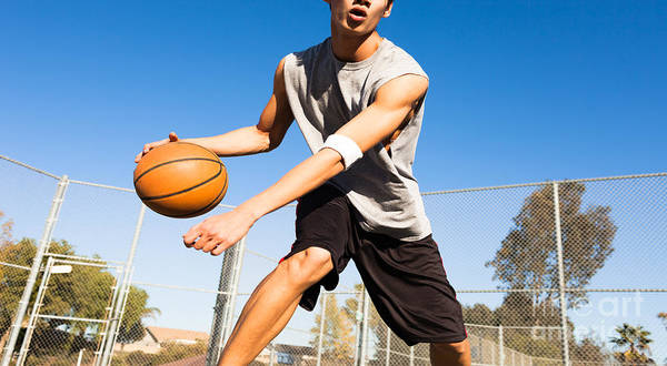 Wall Art - Photograph - Handsome Male Playing Basketball Outdoor by Pkpix