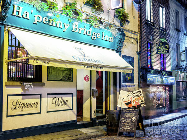 Wall Art - Photograph - Ha'penny Bridge Inn At Night In Dublin by John Rizzuto