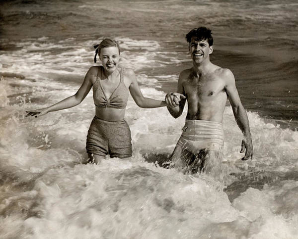 Heterosexual Couple Photograph - Happy Couple In The Surf by George Marks