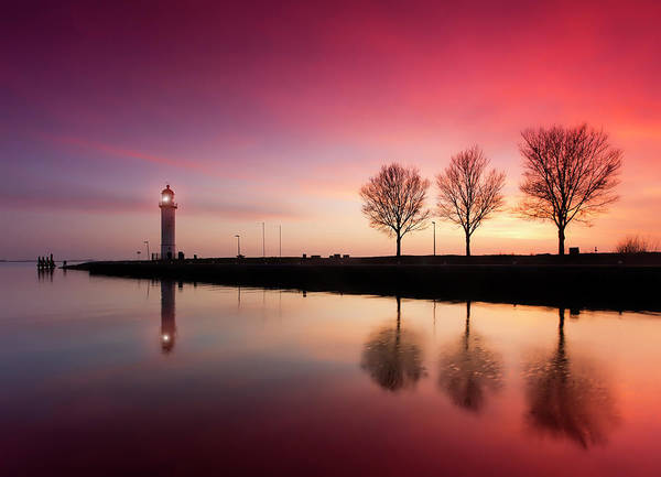 Jetty Photograph - Harbor Jetty And Lighthouse At Sunset by Rob Kints